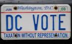 Обама повесил на автомобили кортежа протестный лозунг